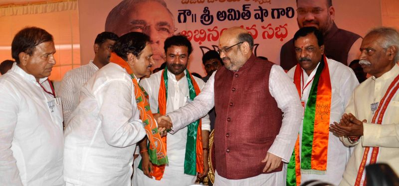 Andhra's former DGP V. Dinesh Reddy joins BJP in presence of party chief Amit Shah during a party programme in Secunderabad on Aug 21, 2014. Also seen BJP leader Bandaru Dattatreya. Also seen BJP ... - V. Dinesh Reddy