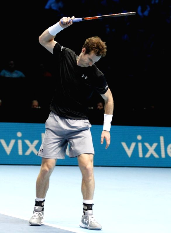 Andy Murray of Britain reacts during the group stage match against Stan Wawrinka of Switzerland at the ATP World Tour Finals in London, Britain, Nov. 20, 2015. ...