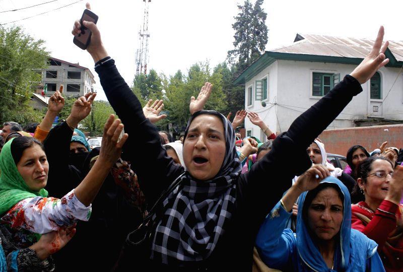 Anganwadi workers stage a demonstration to press for their demands  in Srinagar on Sept 1, 2014.