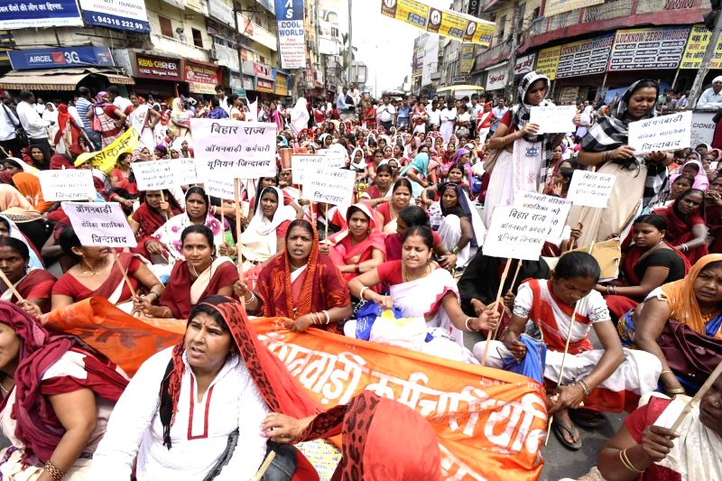 Anganwadi workers stage a demonstration to press for their demands in Patna on April 20, 2017.
