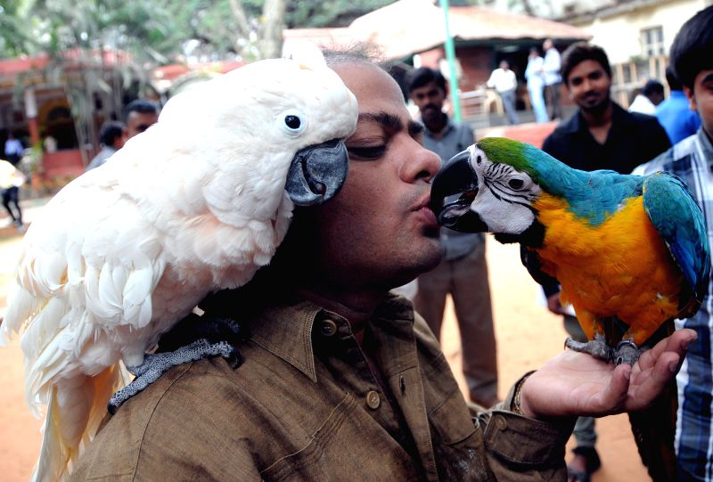 Animal lovers during a press meet regarding `Bengaluru Pet Show 2015` at Jayamahal Palace in Bengaluru on Dec 12, 2014. The Pet Show will be held on from 3rd to 4th January 2015.