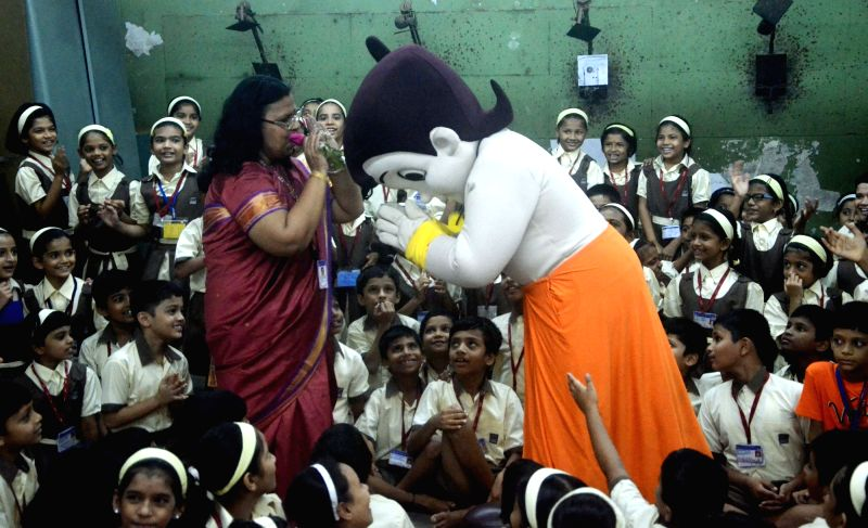Animated character Chhota Bheem with students and teachers during a programme organised on the occasion of Guru Purnima in Mumbai on July 19, 2016.