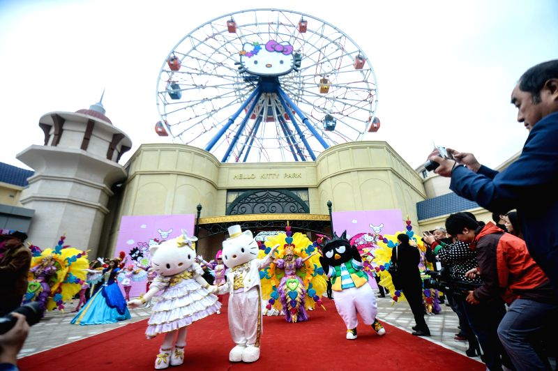 Anji (China): Staff members in cartoon character outfits stage a performance at a ceremony marking the completion of a Hello Kitty theme park in Anji, east China's Zhejiang Province, Nov. 28, 2014. ..