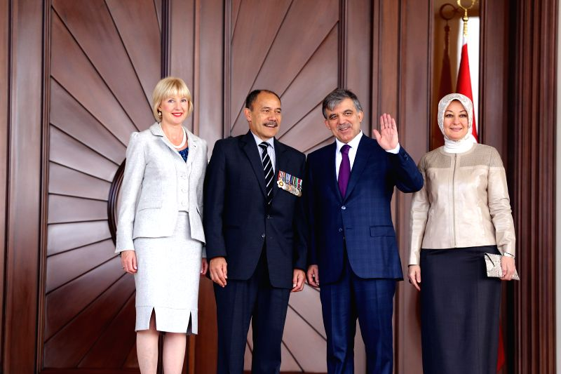 Turkish President Abdullah Gul (2nd R) welcomes visiting New Zealand's Governor-General Jerry Mateparae (2nd L) with a ceremony in Ankara, capital of Turkey, on ...