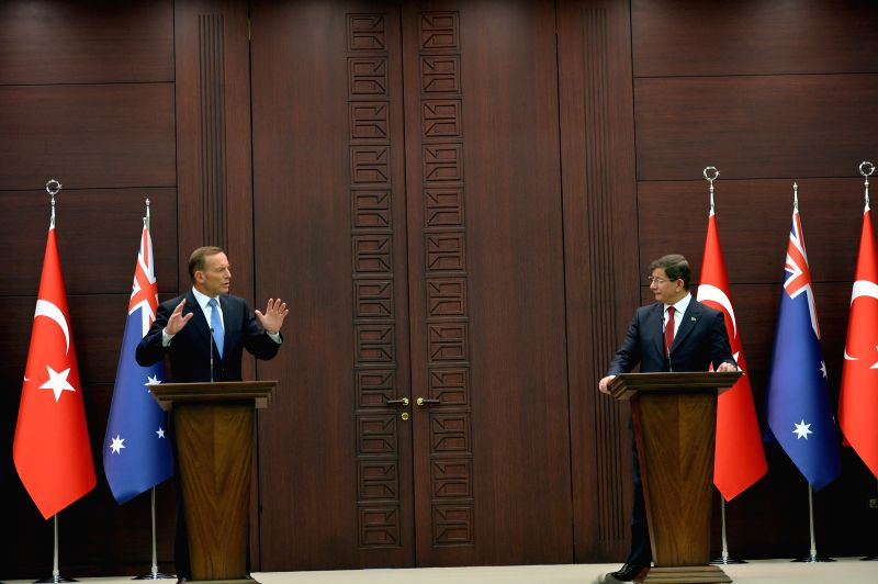 Turkish Prime Minister Ahmet Davutoglu (R) and Australian Prime Minister Tony Abbott attend a joint press conference in Ankara, Turkey, on April 22, 2015. Turkish ... - Ahmet Davutoglu