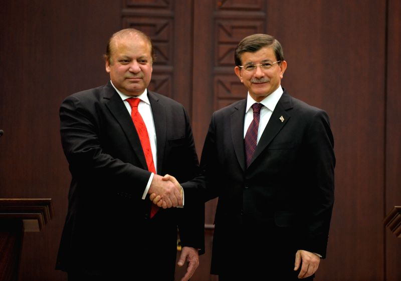 Turkish Prime Minister Ahmet Davutoglu (R) and visiting Pakistani Prime Minister Nawaz Sharif shake hands at the end of the joint press conference in Ankara, Turkey, ... - Ahmet Davutoglu