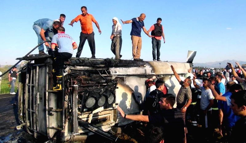 ANKARA, Aug. 1, 2016 - People gather at the explosion scene in Bingol, Turkey, Aug. 1, 2016. A bomb attack in southeastern Turkey killed six police officers and injured four others on Monday, Dogan ...