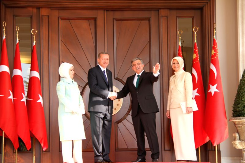Turkey's outgoing president Abdullah Gul (2nd R) and new president Recep Tayyip Erdogan (2nd L) shakes hands during the presidential takeover ceremony in the ...