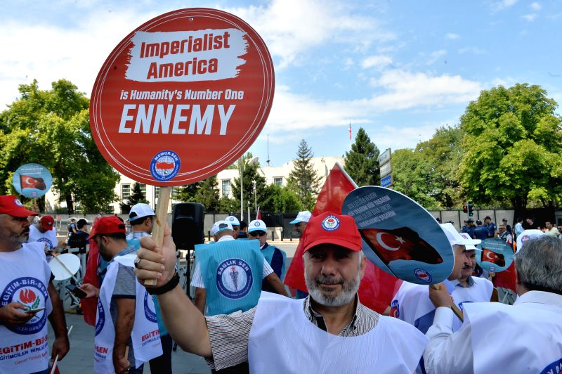 ANKARA, Aug. 3, 2018 - People protest near the U.S. Embassy in Ankara, Turkey, on Aug. 3, 2018, following Washington's unprecedented sanctions on two Turkish ministers over the imprisonment of U.S. ...