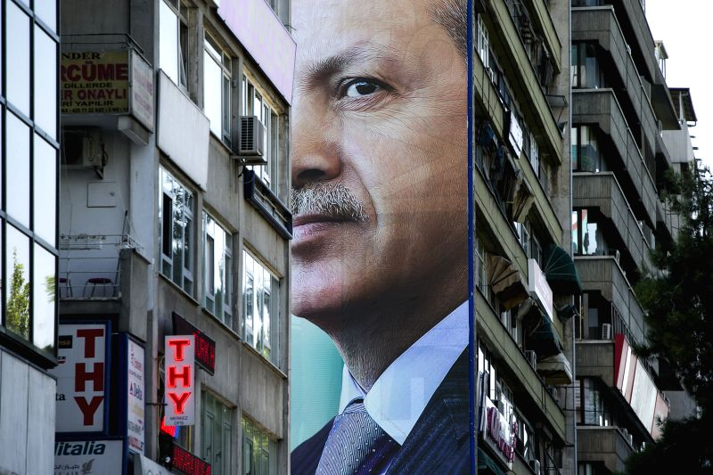 Turkey's Prime Minister and presidential candidate Tayyip Erdogan's giant poster is seen hung on the exterior wall of a residential building in Ankara, capital of ...