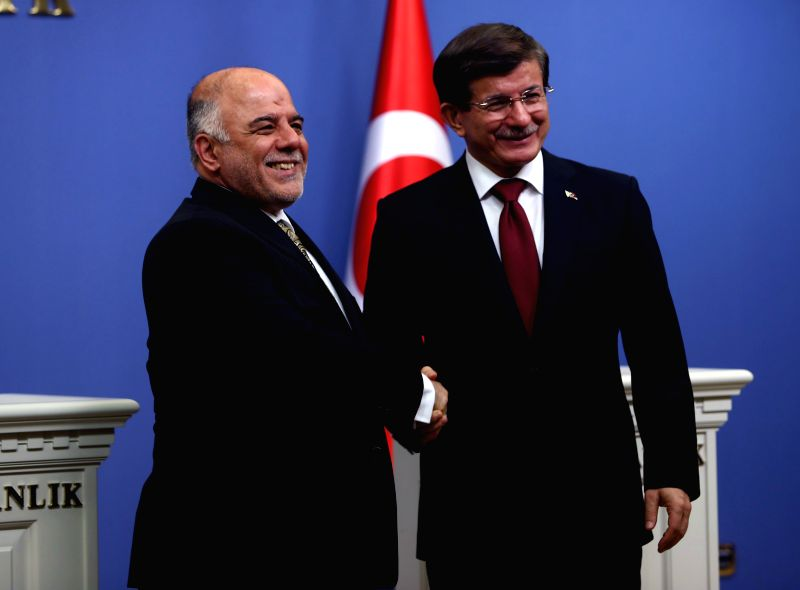 Turkish Prime Minister Ahmet Davutoglu(R) shakes hands with visiting Iraqi Prime Minister Haider al-Abadi during a joint press conference in Ankara, capital of ... - Ahmet Davutoglu