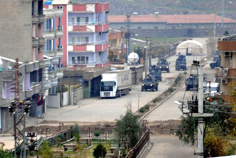 ANKARA, Dec. 27 Police panzers stand by outside the area of clashes between the Kurdish Workers' Party (PKK) and Turkey's Hizbullah in Cizre town of Sirnak Province, Turkey, Dec. 27, ...