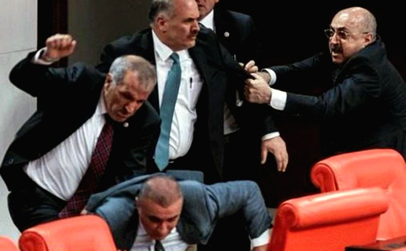 Photo taken on Feb. 17, 2015 shows that four parliamentarians catch up in a fight during the first day of debates in Turkish legislature's General Assembly on a ...