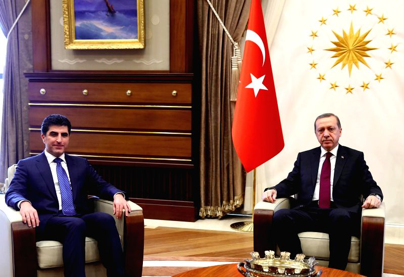 Turkish President Recep Tayyip Erdogan (R) meets with Nechirvan Barzani, prime minister of Iraq's Kurdistan Regional Government, at the new presidential palace in ...
