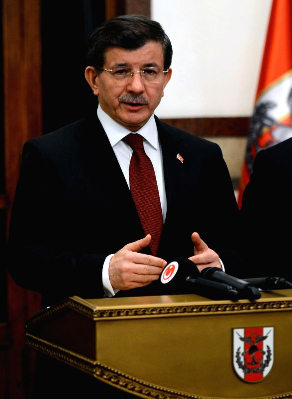 Turkish Prime Minister Ahmet Davutoglu speaks about the military evacuation operation at a press conference in the Turkish capital of Ankara on Feb. 22, 2015. Turkey ... - Ahmet Davutoglu and Suleyman Shah