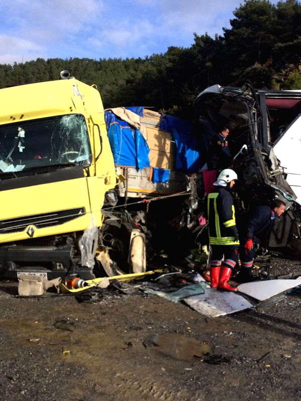 Photo taken on Jan. 29, 2105 shows the traffic accident site on the Gazipasa-Anamur highway in Antalya, Turkey. A passenger bus collided with a truck in the resort ...