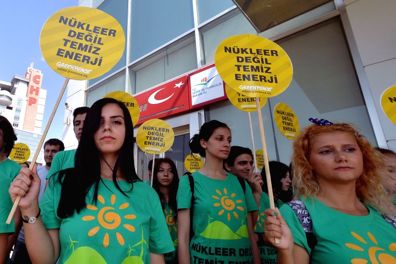 Members of the Greenpeace protest in front of the Ministry of Environment and Urban Planning of Turkey against the construction of nuclear power plants in the country