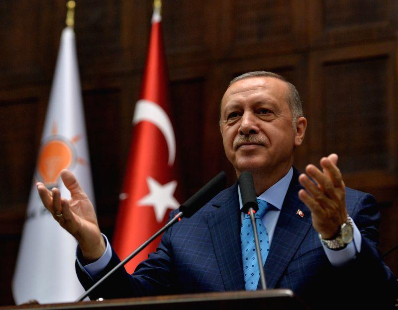 ANKARA, July 24, 2018 - Turkish President Recep Tayyip Erdogan addresses lawmakers at the Turkish parliament in Ankara, Turkey, July 24, 2018. The treatment of Mesut Ozil, a Turkish-German football ...