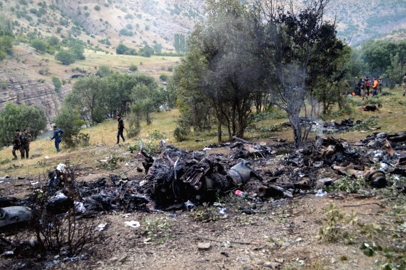 ANKARA, June 1, 2017 - Photo taken on June 1, 2017 shows the wreckage of an helicopter in Sirnak Province, Turkey. Turkish Maj. Gen. Aydogan Aydin died in a military helicopter crash which killed 13 ...