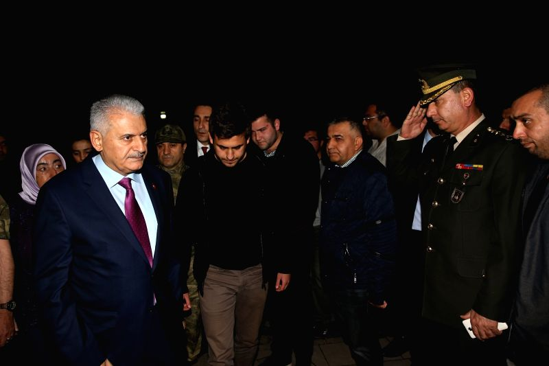 ANKARA, June 1, 2017 - Turkish Prime Minister Binali Yildirim (L) visits the family of a commander who was killed in a military helicopter crash in Ankara, Turkey on May 31, 2017. A total of 13 ... - Binali Yildirim
