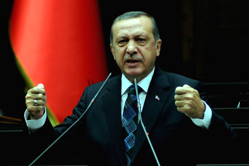 Turkish Prime Minister Recep Tayyip Erdogan gives a speech at the parliamentary group meeting of the ruling Justice and Development Party, in Ankara, Turkey, June ..