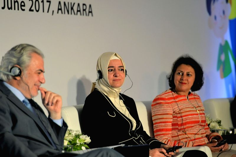 ANKARA, June 8, 2017 - Turkish Family and Social Policies Minister Betul Sayan Kaya (C) participates in the ceremony to launch a program aiming to finance refugee children to get school education in ... - Betul Sayan Kaya