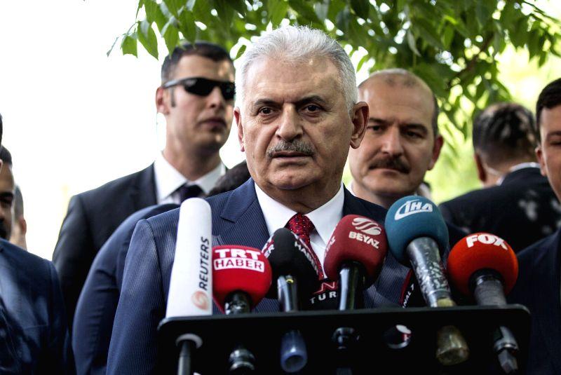ANKARA, June 9, 2017 - Turkish Prime Minister Binali Yildirim (front) speaks to the media in Ankara, Turkey, on June 9, 2017. Turkish Prime Minister Binali Yildirim on Friday called the Kurdish ... - Binali Yildirim