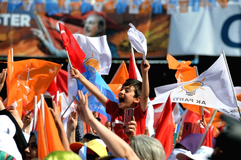 ANKARA, June 9, 2018 - Supporters of Turkish President Recep Tayyip Erdogan wave flags during an election rally of the ruling Justice and Development Party (AKP) in Ankara, Turkey, on June 9, 2018.