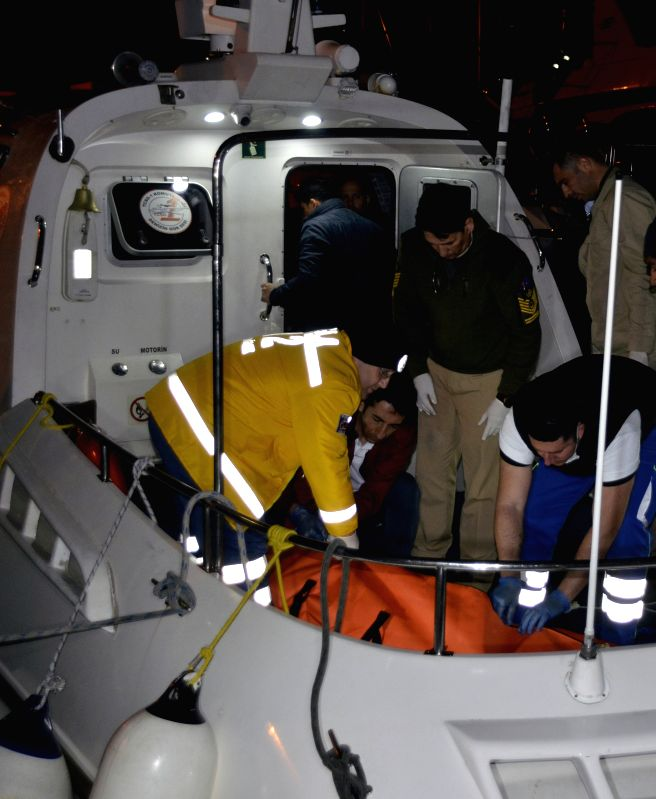 Rescuers work near the site where a migrant boat sank off western Turkey, March 17, 2015. At least five Syrian migrants died on Tuesday when a boat with about 16 ...