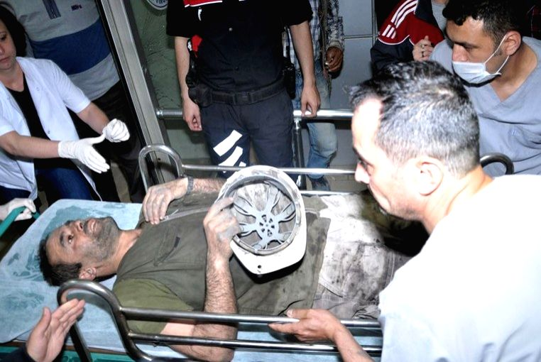 Photo released by Turkey NTV shows rescue efforts being carried out following a coal mine explosion and fire in the district of Soma in Turkey's western Manisa ...