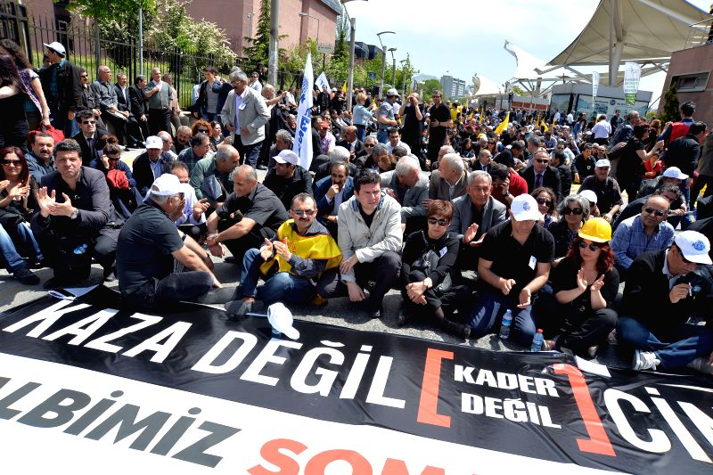 People attend a protest in Ankara, May 15, 2014. A protest erupted in Turkey's capital on Thursday, demanding the government to resign for the responsibility of the ..