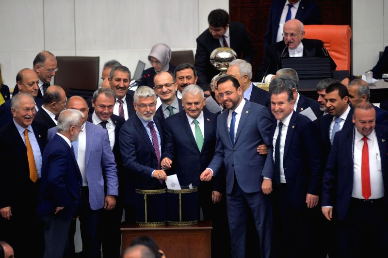 ANKARA, May 20, 2016 - Members of Turkish Parliament pose for a group picture during the voting of an article of constitutional change in Ankara, Turkey, May 20, 2016. Turkey's parliament approved a ...