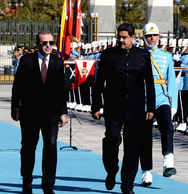 ANKARA, Oct. 6, 2017 - Turkish President Recep Tayyip Erdogan (L, front) and his Venezuelan counterpart Nicolas Maduro (R, front) inspect the guard of honor during a welcome ceremony in Ankara, ...