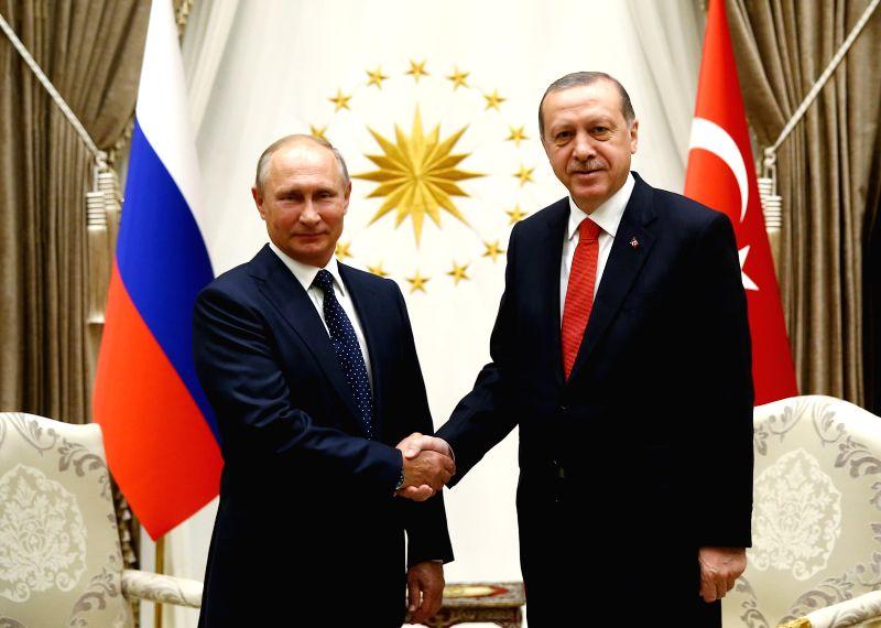 ANKARA, Sept. 29, 2017 - Turkish President Recep Tayyip Erdogan (R) meets with visiting Russian President Vladimir Putin in Ankara Sept. 28, 2017.
