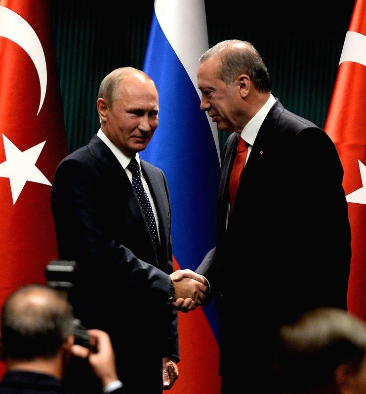 ANKARA, Sept. 29, 2017 - Turkish President Recep Tayyip Erdogan (R) shakes hands with visiting Russian President Vladimir Putin after a joint press conference in Ankara Sept. 28, 2017.