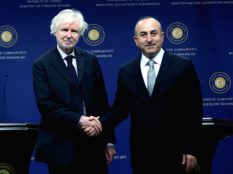Ankara (Turkey): Turkish Foreign Minister Mevlut Cavusoglu (R) shakes hands with his Finnish counterpart Erkki Tuomioja at a joint press conference in Ankara, capital of Turkey, Nov. 18, 2014. ...