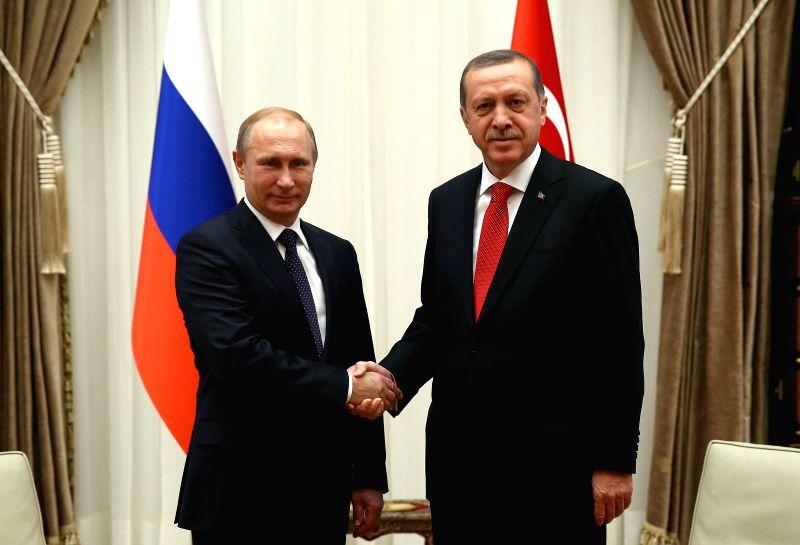 Ankara (Turkey): Turkish President Recep Tayyip Erdogan (R) shakes hands with visiting Russian President Vladimir Putin at the new Presidential Palace in Ankara, Turkey, on Dec. 1, 2014. Russian ...