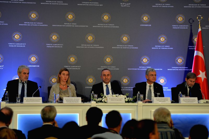 Turkish Foreign Minister Mevlut Cavusoglu (c), EU foreign policy chief Federica Mogherini (2-L) and other senior officials hold a joint press conference in Ankara, Turkey, Dec. 8, 2014. ... - Mevlut Cavusoglu
