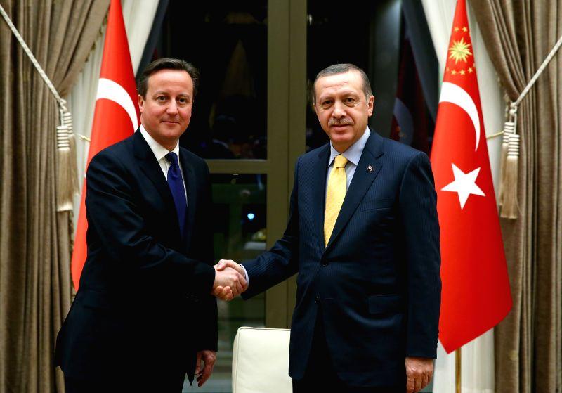 Ankara : Turkish President Recep Tayyip Erdogan (R) meets with visiting  British Prime Minister David Cameron in Ankara, Turkey, on Dec. 9, 2014. Photo: