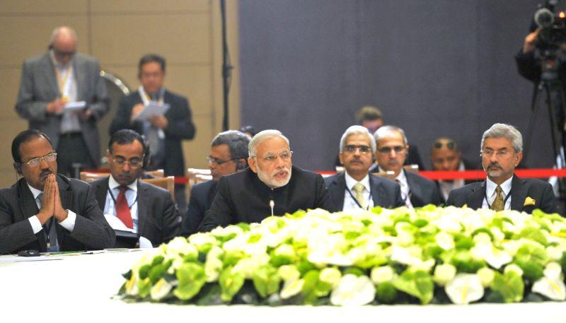 :Antalya: Prime Minister Narendra Modi addresses at the BRICS leaders` meeting, on the sidelines of G20 Turkey 2015, in Antalya, Turkey on Nov 15, 2015. (Photo: IANS/PIB). - Narendra Modi