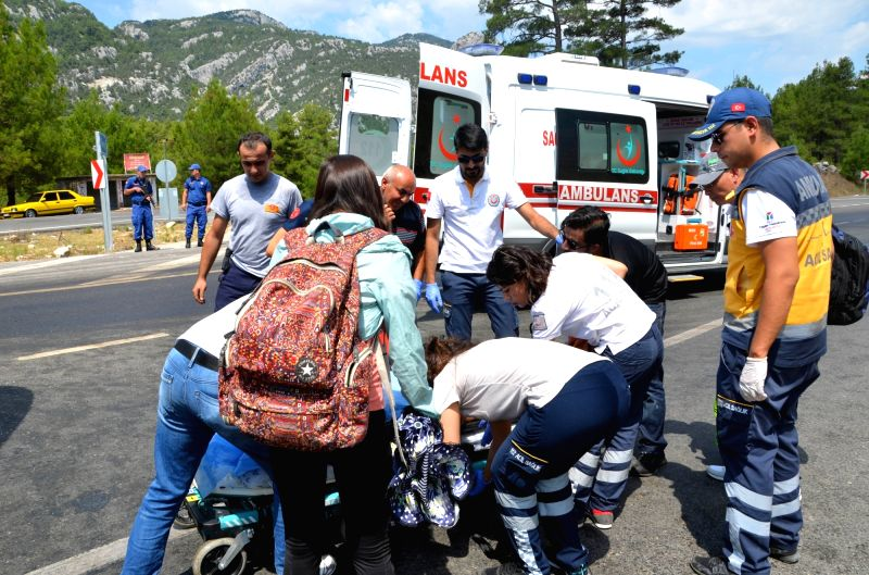 ANTALYA(TURKEY), July 29, 2018 Rescue workers work at the site of a bus accident in Antalya Province, Turkey, July 29, 2018. Two Turkish citizens were killed and 30 other people injured, ...