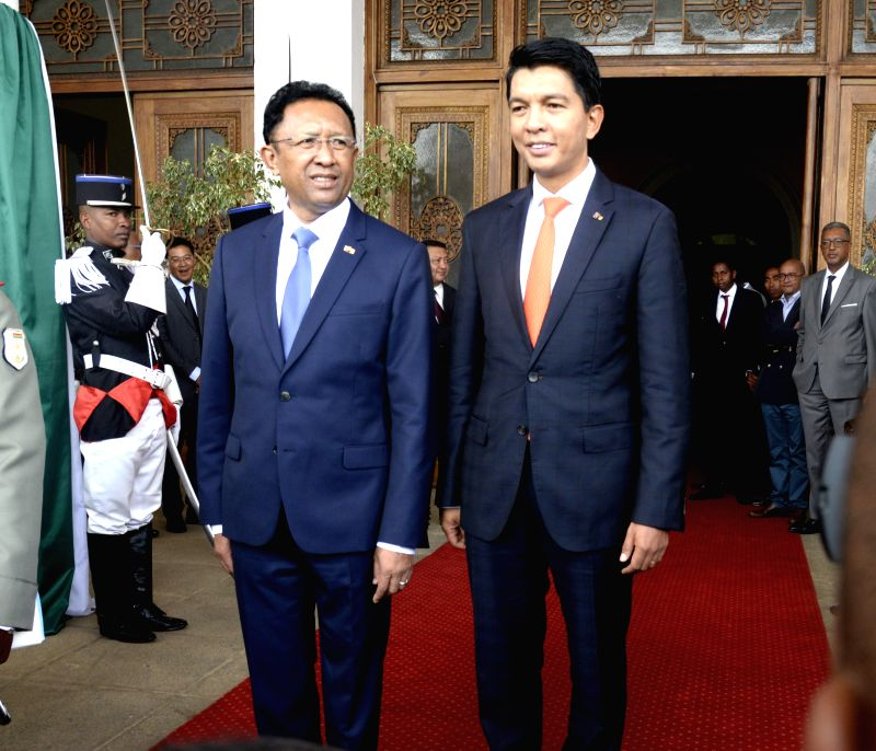 ANTANANARIVO, Jan. 18, 2019 - Andry Rajoelina (R) and Hery Rajaonarimampianina stand in front of the Presidential Palace after the power transfer in Antananarivo, capital of Madagascar on Jan. 18, ...