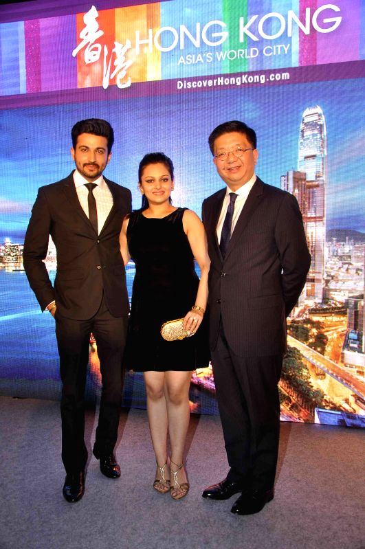 Anthony Lau, ED, Hong Kong Tourism Board, with television actors Nehalaxmi Iyer and Dheeraj Dhoopar during the launch of Hong Kong tourism's new marketing campaign My Time for Hong Kong, in the ...