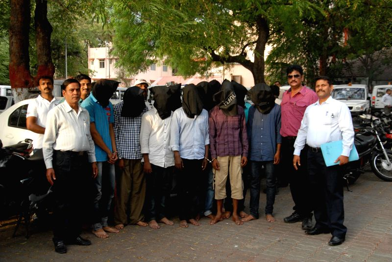Anti-Dacoity Cell (ADC) personnel of Pune city police present before press 10 alleged robbers arrested by them in Pune on June 24, 2014.
