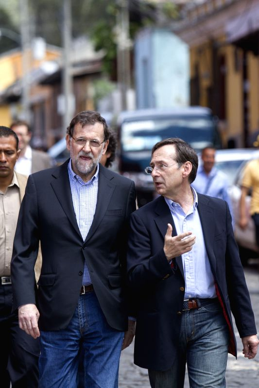 Spanish Prime Minister Mariano Rajoy (L), accompanied by the Secretary of International Cooperation of Spain Gonzalo Robles, walks in a street of the city ... - Mariano Rajoy