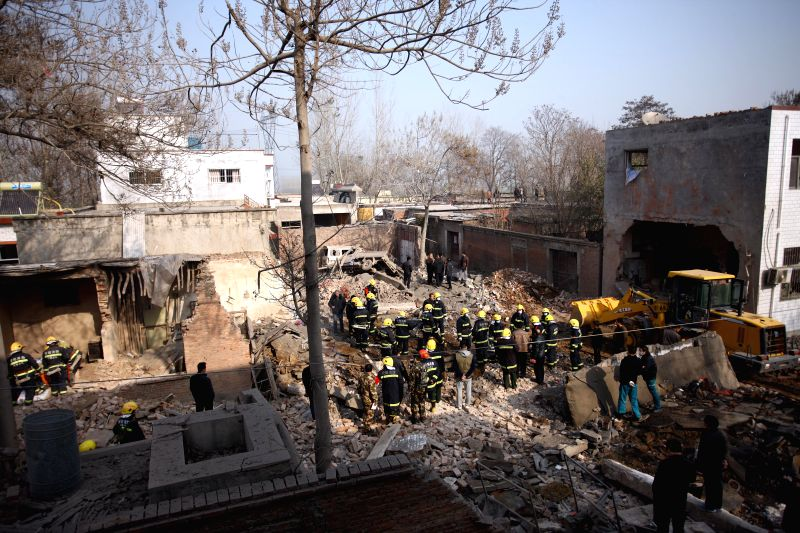 Anyang (China): Firemen search the site of a blast at a fireworks workshop in Zhujiaying Village, Anyang City, central China's Henan Province, Dec. 7, 2014. An explosion in the fireworks workshop ...