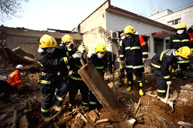 Firemen search the site of a blast at a fireworks workshop in Zhujiaying Village, Anyang City, central China's Henan Province, Dec. 7, 2014. An explosion in the fireworks workshop killed five