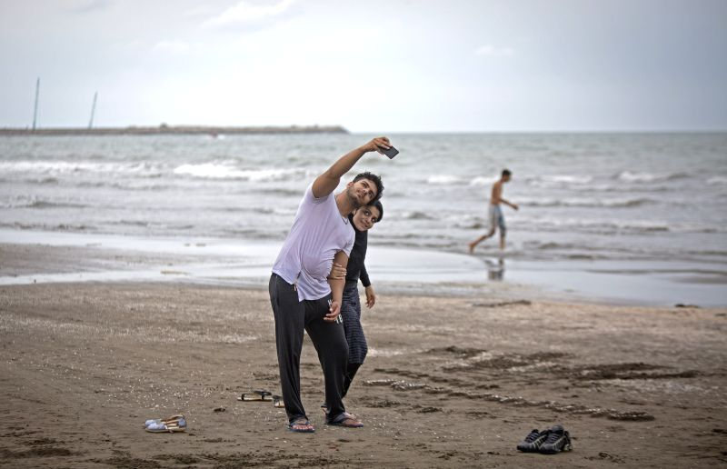 ANZALI, April 27, 2017 - File photo shows an Iranian couple taking selfie at the Caspian sea beach near Anzali Port, northern Iran, on Sept. 5, 2016. Located in West Asia, Iran is an ancient ...