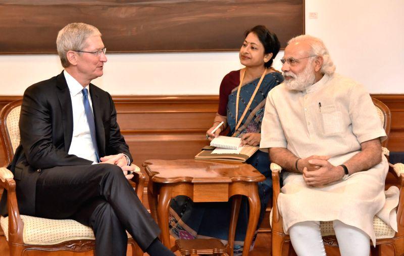 Apple CEO Tim Cook calls on Prime Minister Narendra Modi, in New Delhi on May 21, 2016. (Photo: IANS/PIB) .. - Narendra Modi