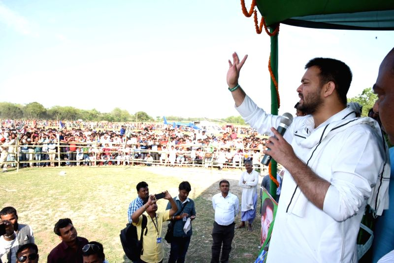 Araria: RJD Leader Tejashwi Yadav addresses a public rally at Narpatganj in Bihar's Araria district, on April 19, 2019. (Photo: IANS)